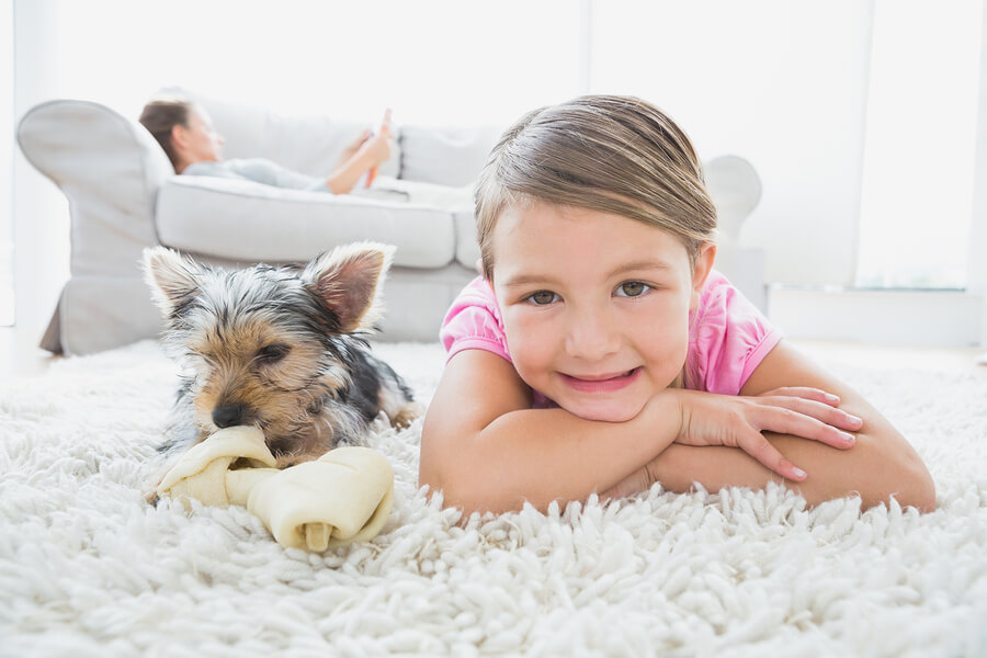 kid and dog laying down