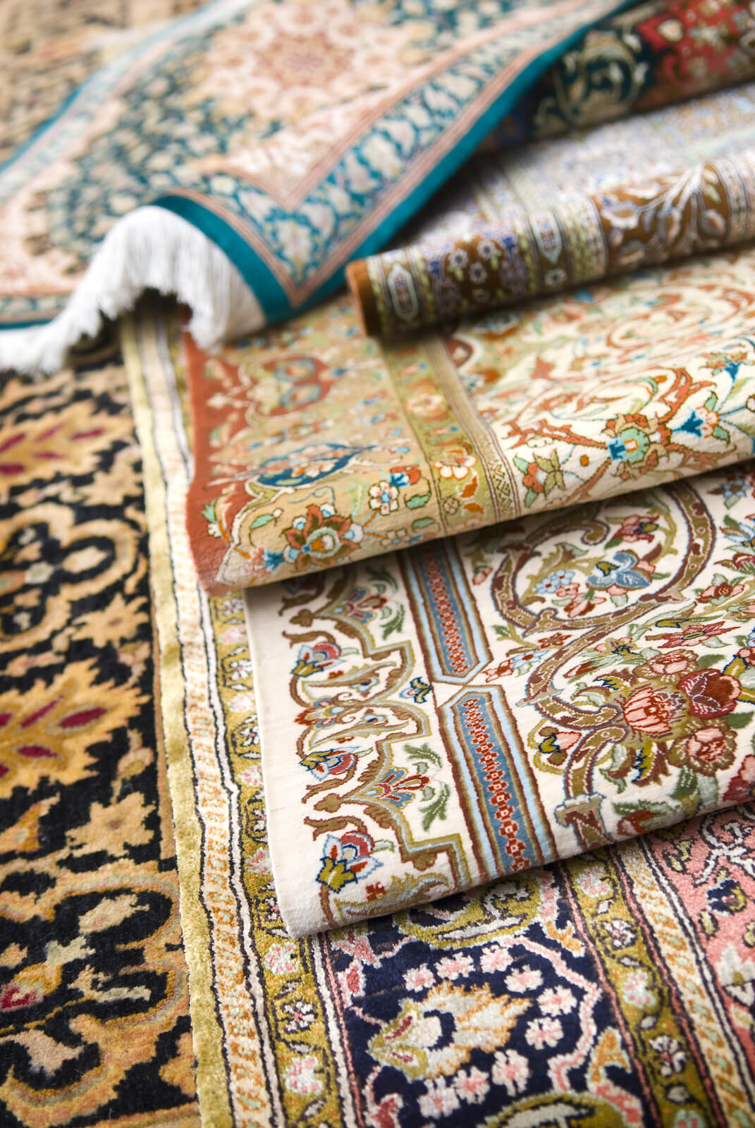 Shallow Focus Image Of Persian Silk Rugs And Oriental Carpets